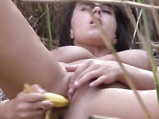 Girl in the reeds humping herself with a banana