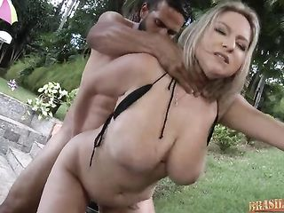 Fucking fat milf with big tits in an inflatable pool