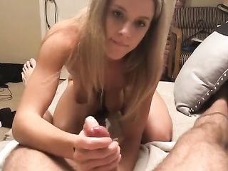 Blonde jerks her husband's dick and massages his prostate