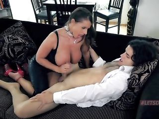 Lady in a leather suit gives herself to a student