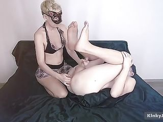 Blonde milking his prostate and make him cum in an unusual pose