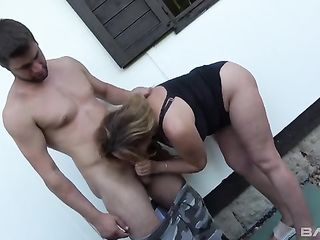 Not a young fat woman fucks a guy in the bushes near the house