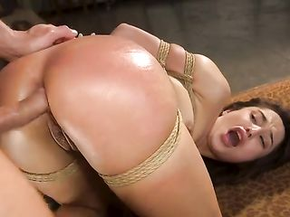 Spanking the ass of a bound woman during sex