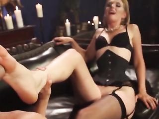 Handsome licks the legs of a blonde in stockings