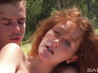 Redhead has sex with a guy in the woods
