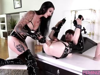 Mistress Damazonia drives a powerful phallus into the ass of Natalie Mars