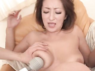 Pulling out vaginal balls and massaging a Japanese woman's pussy with a vibrator