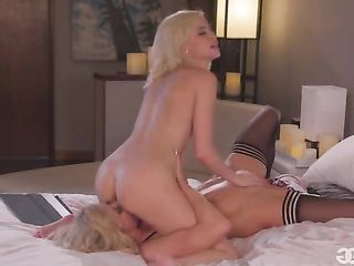 Two blondes engage in anilingus