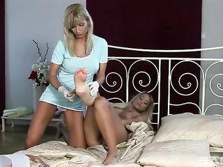Lesbian nurses soaps the blonde's thighs