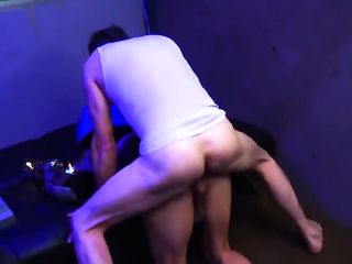 A man fucks a transsexual in a white wig