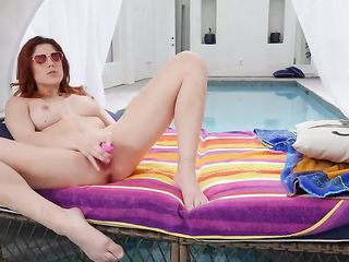 Molly Stewart massages her pussy with a popsicle-shaped vibrator