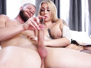 Bearded man inserts a stimulator into his urethra while blonde fondles him