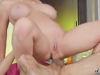 Dee Williams fucks a young guy on the kitchen table