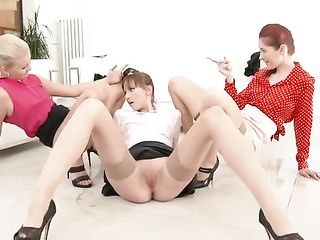Three women in the office pissing