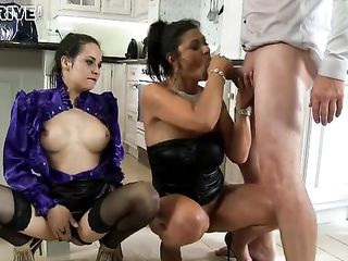 While the brunette sucks her lover's dick, the woman pees on her head