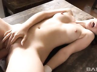 Fucking a young girl on a big wooden table