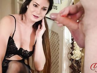 A man masturbates to a lady in stockings