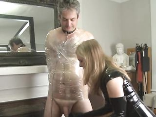 Blonde in a latex dress beats a man's small dick