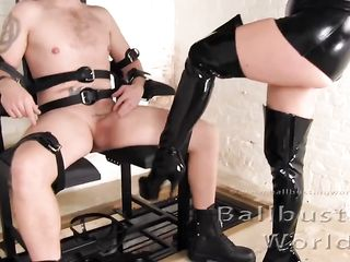 Blonde plays with the dick of a man tied to a chair