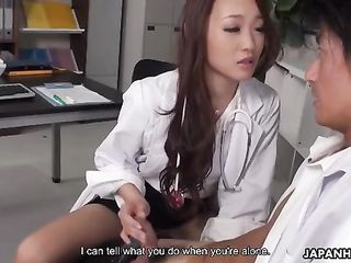 Sexy Japanese nurse gently caresses patient