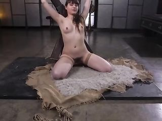 Luna Rival tied to the cross gives a deep blowjob