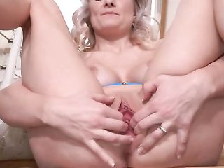 Lily Joy puts a mirror in her vagina and massages with a vibrator