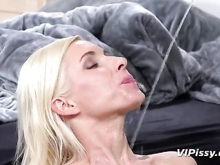 Two long-legged blondes pee on each other