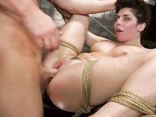 Runs a Wartenberg wheel over the naked body of a bound girl