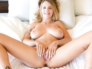 A titsy blonde plays with her pussy