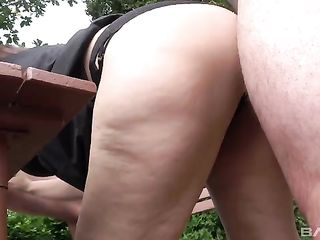 Fat American woman humping in the yard with two young guys