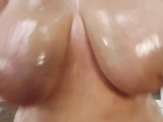 A titty poking a rubber dick in her pussy