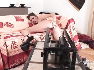 Beautiful girl doggy style in front of a sex machine