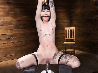 Charlotte Sartre gagged riding a sex machine