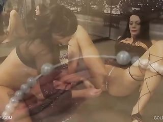 The brunette in a transparent jacket thrust two hands into the vagina of a lady in a corset