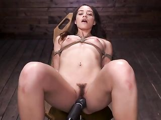 Tied girl's thighs tremble with pleasure during vaginal stimulation